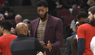 New Orleans Pelicans' Anthony Davis talks during a timeout during the first half of an NBA basketball game against the Chicago Bulls Wednesday, Feb. 6, 2019, in Chicago. (AP Photo/David Banks)
