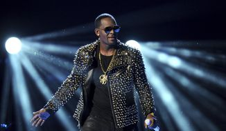 FILE - In this June 30, 2013 file photo, R. Kelly performs at the BET Awards at the Nokia Theatre in Los Angeles. R. Kelly is announcing a new tour, but it won't be in the United States. The embattled entertainer announced on social media Tuesday, Feb. 5, 2019, that he'll be going to Australia, New Zealand and Sri Lanka.  (Photo by Frank Micelotta/Invision/AP, File)