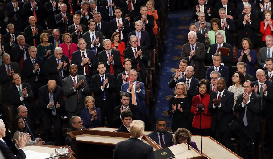 Republicans stand as President Donald Trump delivers his State of the Union address to a joint session of Congress on Capitol Hill in Washington, Tuesday, Feb. 5, 2019. (AP Photo/J. Scott Applewhite)