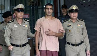 In this Monday, Feb. 4, 2019, photo, Bahraini Hakeem al-Araibi, center, leaves the criminal court in Bangkok, Thailand. Thailand's government insists it cannot free Hakeem who has refugee status in Australia until hearings on Bahrain's request for his extradition are completed.(AP Photo/Sakchai Lalit)