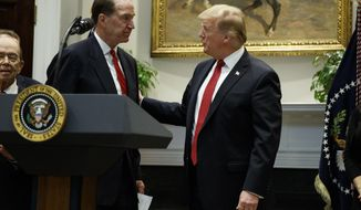 President Donald Trump congratulates David Malpass, under secretary of the Treasury for international affairs, after announcing his nomination to head the World Bank, during an event in the Rosevelt Room of the White House, Wednesday, Feb. 6, 2019, in Washington. (AP Photo/ Evan Vucci)