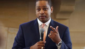 In this Sept. 25, 2018, file photo, Virginia Lt. Gov. Justin Fairfax gestures during remarks before a meeting of the Campaign to reduce evictions at a church meeting room in Richmond, Va. A California woman has accused Fairfax of sexually assaulting her 15 years ago, saying in a statement Wednesday, Feb. 6, 2019, that she repressed the memory for years but came forward in part because of the possibility that Fairfax could succeed a scandal-mired governor. (AP Photo/Steve Helber) **FILE**