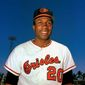 FILE - In this 1967 file photo, Baltimore Orioles outfielder Frank Robinson smiles. Hall of Famer Frank Robinson, the first black manager in Major League Baseball and the only player to win the MVP award in both leagues, has died. He was 83. Robinson had been in hospice care at his home in Bel Air. MLB confirmed his death Thursday, Feb. 7, 2019.(AP Photo/File) **FILE**