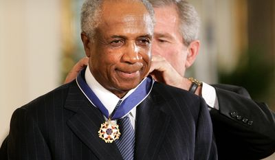 Hall of Famer Frank Robinson was honored by President George W. Bush with the Presidential Medal of Freedom Award at the White House in 2005. Robinson, the first black manager in Major League Baseball, died on Thursday. He was 83. He had been in hospice care at his home in Bel Air, Maryland.