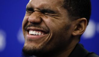 Philadelphia 76ers' Tobias Harris laughs during a news conference at the NBA basketball team's practice facility in Camden, N.J., Thursday, Feb. 7, 2019. (AP Photo/Matt Rourke)