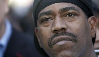 Hip-Hop pioneer Kurtis Blow looks on before taking part in a march for decency in music on James Brown?s birthday Thursday, May 3, 2007 at  New York.  (AP Photo/Frank Franklin II)