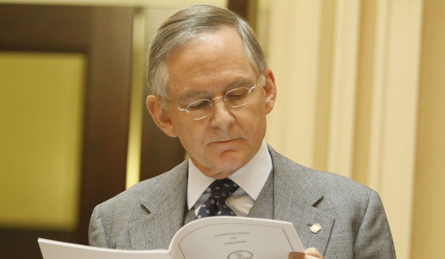 State Sen. Tommy Norment, R-James City County, looks over rules of the Senate during debate on the new Senate rules at the start of the 2012 session of the Virginia Senate at the Capitol in Richmond, Va., Wednesday, Jan. 11, 2012. (AP Photo/Steve Helber)