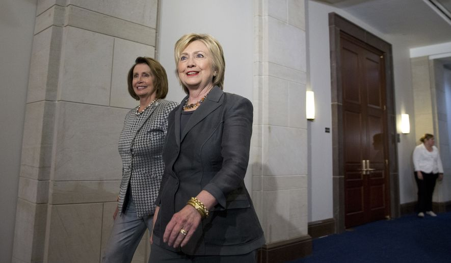 Democratic presidential candidate Hillary Clinton walks with House Minority Leader Nancy Pelosi of Calif. as they arrive for a meeting with the House Democratic Caucus, Wednesday, June 22, 2016, on Capitol Hill in Washington. (AP Photo/Alex Brandon)