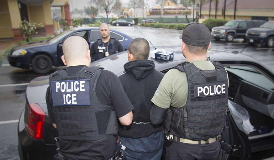 This Tuesday, Feb. 7, 2017, file photo released by U.S. Immigration and Customs Enforcement, shows foreign nationals being arrested this week during a targeted enforcement operation conducted by U.S. Immigration and Customs Enforcement (ICE) aimed at immigration fugitives, re-entrants and at-large criminal aliens in Los Angeles. (Charles Reed/U.S. Immigration and Customs Enforcement via AP) ** FILE **