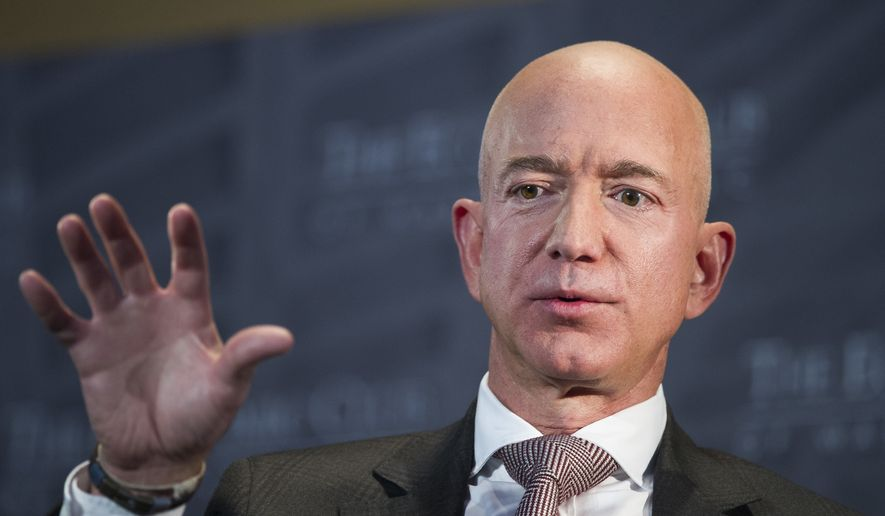 In this Sept. 13, 2018, file photo Jeff Bezos, Amazon founder and CEO, speaks at The Economic Club of Washington's Milestone Celebration in Washington. (AP Photo/Cliff Owen, File)