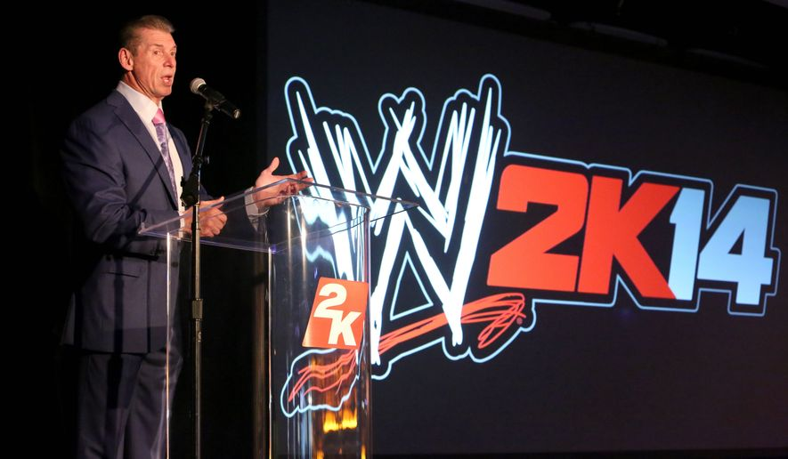 IMAGE DISTRIBUTED FOR 2K - WWE Chairman and CEO Mr. McMahon welcomes guests to the WWE 2K14 press event, on Saturday, Aug. 17, 2013 in Los Angeles.  (Photo by Casey Rodgers/Invision for 2K/AP Images)