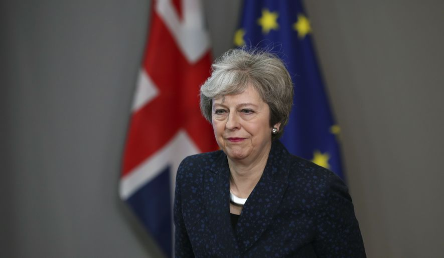 Britain's Prime Minister Theresa May leaves after her meeting with European Council President Donald Tusk at the European Council headquarters in Brussels, Thursday, Feb. 7, 2019. (AP Photo/Francisco Seco)