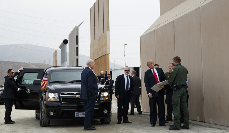 In this March 13, 2018, photo, President Donald Trump reviews border wall prototypes in San Diego. (Associated Press) ** FILE **