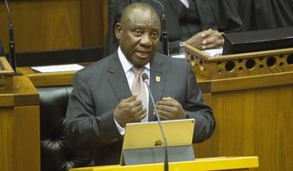 South African President Cyril Ramaphosa makes his State of the Nation address in parliament, in Cape Town, South Africa, Thursday, Feb. 7, 2019. Ramaphosa's speech to parliament comes three months before national elections May 8 that is seen by many as a referendum on his ruling African National Congress. (Rodger Bosch, Pool via AP)