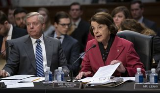 Senate Judiciary Committee Chairman Lindsey Graham, R-S.C., listens at left as Sen. Dianne Feinstein, D-Calif., the ranking member, objects to advancing the nomination of Bill Barr to be attorney general, on Capitol Hill in Washington, Thursday, Feb. 7, 2019. (AP Photo/J. Scott Applewhite)