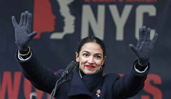 In this Jan. 19, 2019, file photo, U.S. Rep. Alexandria Ocasio-Cortez, (D-New York) waves to the crowd after speaking at Women's Unity Rally in Lower Manhattan in New York. Democrats including Ocasio-Cortez of New York and veteran Sen. Ed Markey of Mass. are calling for a Green New Deal intended to transform the U.S. economy to combat climate change and create jobs in renewable energy. (AP Photo/Kathy Willens, File) **FILE**