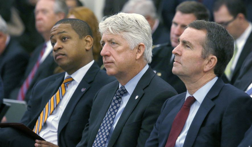 In this Dec. 18, 2017, file photo, from left, Lt. Gov.-elect Justin Fairfax, Attorney General-elect Mark Herring and Gov.-elect Ralph Northam listen as Virginia Gov. Terry McAuliffe addresses a joint meeting of the House and Senate money committees at the Pocahontas Building in Richmond, Va. With Virginia's top three elected officials engulfed in scandal, fellow Democrats were rendered practically speechless, uncertain of how to thread their way through the racial and sexual allegations and their tangled political implications. (Bob Brown/Richmond Times-Dispatch via AP)