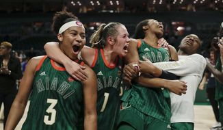 Miami's India Banks, aura Cornelius and Kelsey Marshall, from left, celebrate the team's win over Notre Dame in an NCAA college basketball game Thursday, Feb. 7, 2019, in Coral Gables, Fla. (AP Photo/Brynn Anderson)