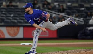 FILE - In this April 20, 2018, file photo, Toronto Blue Jays pitcher Ryan Tepera delivers against the New York Yankees during the eighth inning of a baseball game, in New York. Reliever Ryan Tepera has gone to salary arbitration with the Toronto Blue Jays. Tepera asked for $1.8 million during Wednesday's, Feb. 6, 2019, hearing and the team argued for $1,525,000. A decision by arbitrators Mark Burstein, Howard Edelman and Edna Francis is expected Thursday.(AP Photo/Julie Jacobson, File)