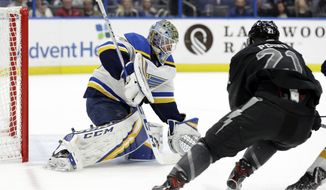 St. Louis Blues goaltender Jordan Binnington (50) makes a save on a shot by Tampa Bay Lightning center Brayden Point (21) during the second period of an NHL hockey game Thursday, Feb. 7, 2019, in Tampa, Fla. (AP Photo/Chris O'Meara)