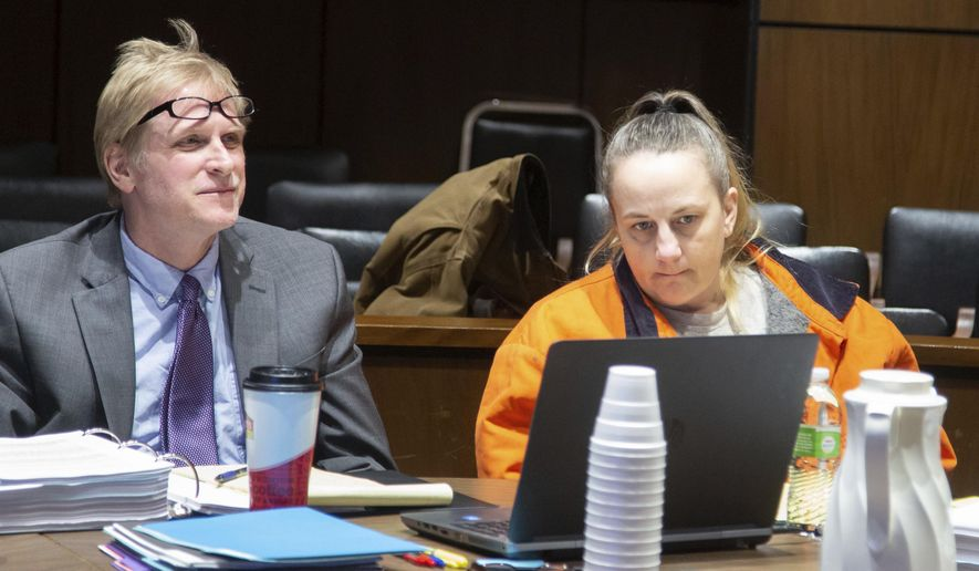 In this Tuesday, Feb. 5, 2019 photo, Traci Tyler sits with attorney Ted Fisher during her trial at the Hardin County Courthouse in Eldora, Iowa. Tyler is accused of helping torture her boyfriend's 8-year-old son and confining him in a basement. (Zach Boyden-Holmes/The Des Moines Register via AP)