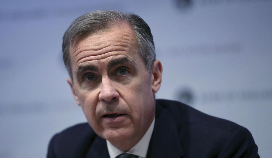 The Governor of the Bank of England, Mark Carney speaks during a news conference at the Bank of England in London, Thursday Feb. 7, 2019. The Bank of England said that Brexit uncertainties and a weaker global economy overall, mean that British growth in 2019 is likely to be 1.2 percent, and they will keep its main interest rate at 0.75 percent. (Hannah McKay/Pool via AP)