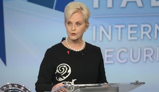 In this Nov. 17, 2018, file photo, Cindy McCain pauses while presenting the inaugural John McCain Prize for Leadership in Public Service to the People of the island of Lesbos, Greece, at the Halifax International Security Forum in Halifax, Canada. (Darren Calabrese/The Canadian Press via AP)