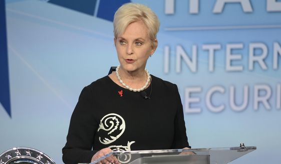 In this Nov. 17, 2018, file photo, Cindy McCain pauses while presenting the inaugural John McCain Prize for Leadership in Public Service to the People of the island of Lesbos, Greece, at the Halifax International Security Forum in Halifax, Canada. (Darren Calabrese/The Canadian Press via AP) ** FILE **