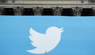 FILE- In this Nov. 7, 2013, file photo, a Twitter sign is draped on the facade of the New York Stock Exchange before its IPO in New York. Twitter reports financial results Thursday, Feb. 7, 2019. (AP Photo/Mark Lennihan, File)