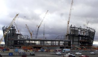 This Jan. 17, 2019, photo shows the construction site for the future Raiders stadium in Las Vegas. In 2018, 10 companies began efforts to leave Nevada's utility monopoly, NV Energy. Others are still under construction, such as the Raiders' Las Vegas stadium and the MSG Sphere Las Vegas music and entertainment venue. (Bizuayehu Tesfaye/Las Vegas Review-Journal via AP)