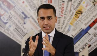 FILE - In this Nov.9, 2018 file photo, Italian deputy Premier and Labor Minister Luigi Di Maio talks to reporters during a press conference at the Foreign Press Association headquarters, in Rome. France is recalling its ambassador to Italy amid mounting tensions, after Di Maio met with French yellow vest protesters and offered to support their anti-government movement. (AP Photo/Andrew Medichini, File)