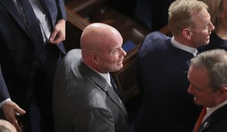 In this Feb. 5, 2019, photo, acting Attorney General Matthew Whitaker, center,  and acting Secretary of Defense Patrick Shanahan, right, and members of President Donald Trump's cabinet arrive to attend the State of the Union address to a joint session of Congress on Capitol Hill in Washington. (AP Photo/Andrew Harnik)