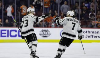 Los Angeles Kings' Tyler Toffoli, left, and Oscar Fantenberg celebrate after Toffoli's goal during a shootout in an NHL hockey game against the Philadelphia Flyers, Thursday, Feb. 7, 2019, in Philadelphia. (AP Photo/Matt Slocum)
