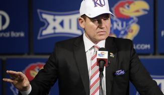 FILE - In this Nov. 18, 2018, file photo, University of Kansas new NCAA college football coach Les Miles makes a statement during a news conference in Lawrence, Kan. Miles and Kansas State counterpart Chris Klieman wrap up their initial recruiting classes, both having hit the ground running in their new gigs. (AP Photo/Orlin Wagner, File)