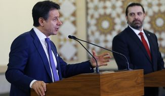 Italian Prime Minister Giuseppe Conte, left, speaks during a joint press conference with his Lebanese counterpart Saad Hariri, at the Government House in Beirut, Lebanon, Thursday, Feb. 7, 2019. (AP Photo/Bilal Hussein)