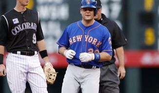 FILE - In this Wednesday, June 20, 2018 file photo, New York Mets' Devin Mesoraco stands at second after hitting a two-run double off Colorado Rockies starting pitcher Chad Bettis during the first inning of a baseball game in Denver. Catcher Devin Mesoraco is staying with the New York Mets, agreeing to a minor league contract, Thursday, Feb. 7, 2019. If added to the 40-man roster, the 30-year-old would get a one-year contract paying at a rate of $1.75 million while in the major leagues. (AP Photo/David Zalubowski, File)