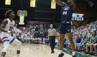 Nevada forward Jordan Caroline, right, shoots a 3-pointer over Colorado State guard Kris Martin during the first half of an NCAA college basketball game Wednesday, Feb. 6, 2019, in Fort Collins, Colo. (AP Photo/David Zalubowski) ** FILE **