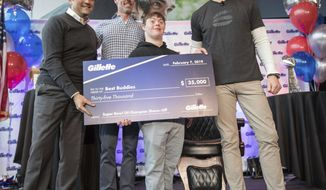 IMAGE DISTRIBUTED  FOR GILLETTE -  New England Patriots quarterback Tom Brady celebrates his sixth Super Bowl win with a fresh shave at Gillette World Shave Headquarters on Thursday, Feb. 07, 2019 in Boston. Together, Brady and Gillette donated more than $100,000 to three organizations: Boys & Girls Club of South Boston, Best Buddies and Dana-Farber Cancer Institute. (Scott Eisen/AP Images for Gillette)
