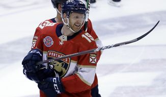 Florida Panthers defenseman Mike Matheson (19) smiles after scoring the game-winning goal during overtime of an NHL hockey game against the Pittsburgh Penguins, Thursday, Feb. 7, 2019, in Sunrise, Fla. The Panthers won 3-2 in overtime. (AP Photo/Lynne Sladky)