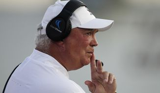 FILE - In this Aug. 25, 2018, file photo, Massachusetts coach Mark Whipple watches from the sideline during the first half of the team's NCAA college football game against Duquesne in Amherst, Mass. Pittsburgh coach Pat Narduzzi's biggest coup during the offseason might be the 61-year-old passing game guru with a reputation as a quarterback whisperer. (AP Photo/Michael Dwyer, File)