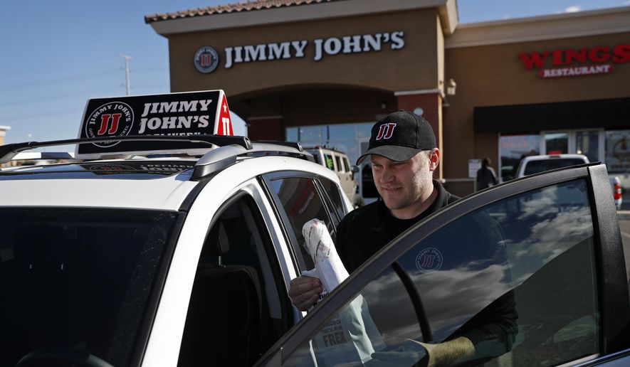 In this Wednesday, Feb. 6, 2019, photo, Tyler Schwecke, a delivery driver for Jimmy John's, gets in his car to make a delivery in Las Vegas. Food delivery services like Uber Eats and GrubHub are taking off like a rocket, but some restaurants aren't on board. This week, Jimmy John's sandwich chain launched a national ad campaign promising never to use third-party delivery. (AP Photo/John Locher) **FILE**