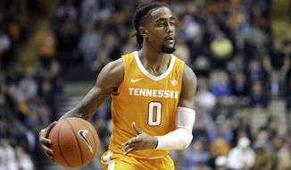 FILE - In this Jan. 23, 2019, file photo, Tennessee guard Jordan Bone plays against Vanderbilt in an NCAA college basketball game in Nashville, Tenn. The Volunteers don't have a single top-100 recruit on their roster, yet they're ranked No. 1 and have a school-record 17 straight victories for the longest active winning streak of any Division I team. (AP Photo/Mark Humphrey, File)