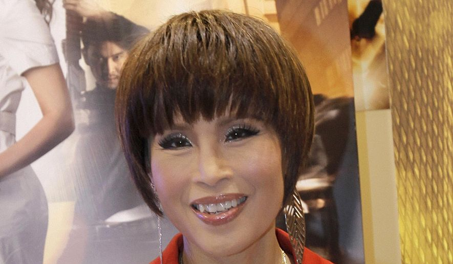 In this March 24, 2010, file photo, Thai Princess Ubolratana poses for a photo during her visit to promote Thailand's film industry at the Entertainment Expo Hong Kong Filmart. Thai Raksa Chart party selected Friday, Feb. 8, 2019, the princess as its nominee to serve as the next prime minister, upending tradition that the royal palace plays no public role in politics and upsetting all predictions about what may happen in the March election. (AP Photo/Vincent Yu)