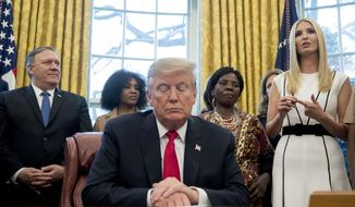 """Ivanka Trump, the daughter of President Donald Trump, right, accompanied by President Donald Trump, center, and Secretary of State Mike Pompeo, left, speaks before Trump signs the National Security Presidential Memorandum to Launch the """"Women's Global Development and Prosperity"""" Initiative in the Oval Office of the White House in Washington, Thursday, Feb. 7, 2019. (AP Photo/Andrew Harnik)"""