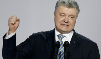 Ukrainian President Petro Poroshenko gestures while speaking at a meeting with supporters in Kiev, Ukraine, Tuesday, Jan. 29, 2019. Poroshenko declared his intention to run for re-election in March's presidential vote. (AP Photo/Efrem Lukatsky)