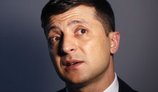 Ukrainian comedian and presidential candidate Volodymyr Zelenskiy speaks during his interview with The Associated Press, in Kiev, Ukraine, Wednesday, Feb. 6, 2019. Zelenskiy, who has taken the lead in Ukraine's presidential race, says his popularity reflects the public disillusionment with the nation's politicians. (AP Photo/Efrem Lukatsky)