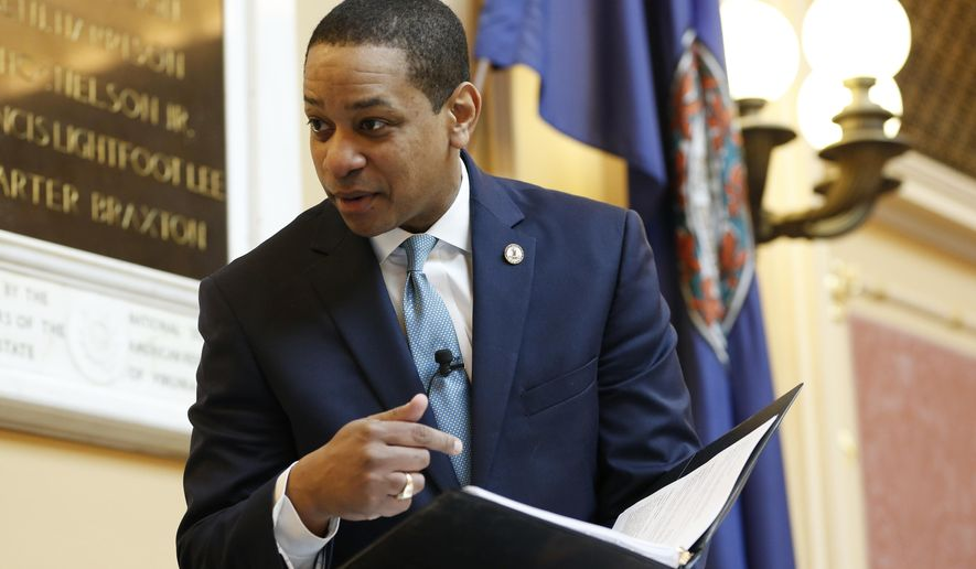 Virginia Lt. Gov Justin Fairfax looks over a briefing book prior to the start of the senate session at the Capitol in Richmond, Va., Thursday, Feb. 7, 2019. A California woman has accused Fairfax of sexually assaulting her 15 years ago. (AP Photo/Steve Helber)