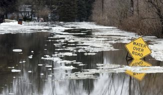 Water and ice cover Derfla Road in Royalton Township, Mich., Wednesday Feb. 6, 2019, as recent mild temperatures caused the area to flooding. (Don Campbell/The Herald-Palladium via AP)