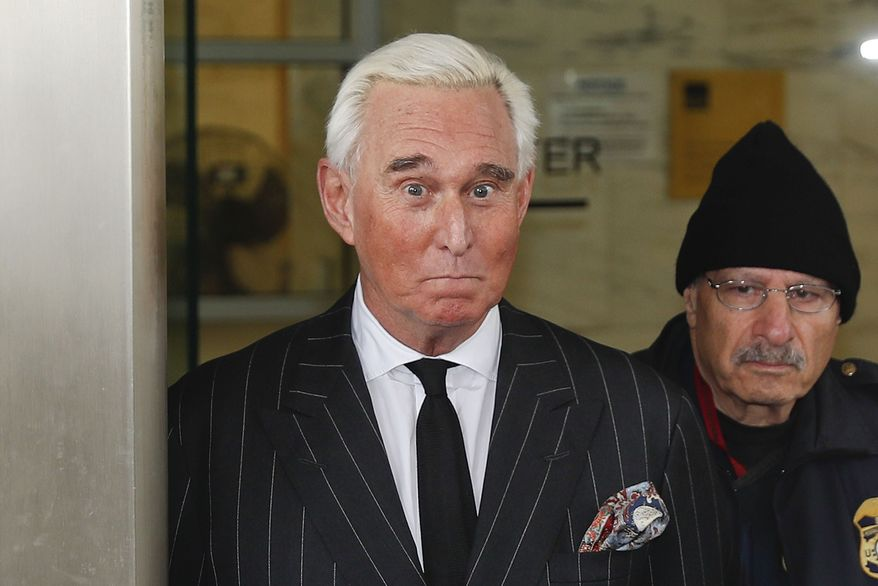 In this Feb. 1, 2019 file photo, former campaign adviser for President Donald Trump, Roger Stone, leaves federal court in Washington.  (AP Photo/Pablo Martinez Monsivais)