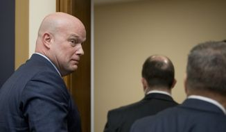 Acting Attorney General Matthew Whitaker departs after testifying before the House Judiciary Committee on Capitol Hill, Friday, Feb. 8, 2019, in Washington. Democrats pressed him on his interactions with President Donald Trump and his oversight of the special counsel's Russia investigation. (AP Photo/Andrew Harnik)